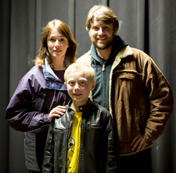 """Christina Rohling as """"Wendy,"""" Marc Erickson as """"Jack"""" and Christopher Levering as """"Danny"""" in Stephen King's """"The Shining,"""" A Play."""