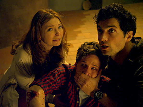 "Brigid Brannagh as Becky Westlake, Kris Lemche as Alex Torini and David Alpay as Greg Abernathy in ""They're Watching"""